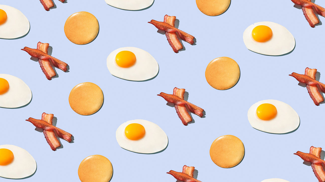Illustration of fried eggs and bacon and pancakes for Grab-and-Go Breakfast Meal Prep Ideas