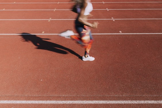 Woman sprinting on a track